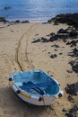 Boat On The Sand In The Old Town Harbor Harbour Corralejo Fuerte Stock Images - 48756434