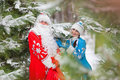 Ded Moroz (Father Frost) And Snegurochka (Snow Maiden) With Gifts Bag Royalty Free Stock Photos - 48768658