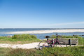 Purple Bike And Wood Bench By Beach Royalty Free Stock Images - 48770599