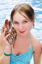 Young Girl With Seashell Royalty Free Stock Photo - 4884725