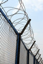 Fence With Barbed Wire Stock Photography - 4889402
