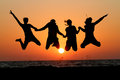 Friends Jumping In Sunset At Beach Royalty Free Stock Image - 48804836