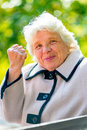 Gray-haired Old Lady Shows A Fist Royalty Free Stock Photography - 48807097