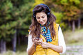 Portrait Of Beautiful Young Woman Listening Music Outdoor.Enjoying Music Stock Photo - 48823440