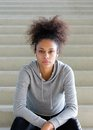 Young African American Woman Sitting On Steps With Headphones Stock Photo - 48849630