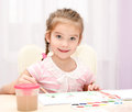 Cute Smiling Little Girl Drawing With Paint And Paintbrush Royalty Free Stock Image - 48850626