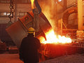 Steel Works Steel Production. Molten, Glowing, Red, Yellow, White, Metal Pouring From Bucket In The Form Of Fiery Sparks Fly, Work Royalty Free Stock Image - 48850886