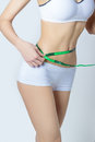 Young Sports A Beautiful Slim Woman Measuring Perfect Shape Nice Hips, The Concept Of A Healthy Lifestyle On A White Background Royalty Free Stock Photos - 48855168