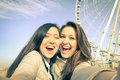 Young Women Girlfriends Taking A Selfie At Luna Park Royalty Free Stock Photography - 48868357