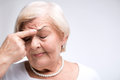 Elderly Lady Touching Her Head With Finger Royalty Free Stock Images - 48871239
