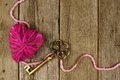 Heart And Key On Old Wood Stock Photography - 48877222