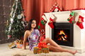 Smiling Woman In Santa Helper Hat Over Living Room With Christmas Tree Background Stock Photo - 48896460
