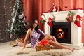 Smiling Woman In Santa Helper Hat Over Living Room With Christmas Tree Background Royalty Free Stock Photos - 48897168