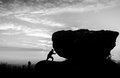 Hard Work.The Person Rolls The Rock On Mountain. Stock Photo - 48936690