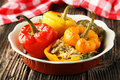 Red And Yellow Peppers Stuffed With The Meat, Rice And Vegetables Stock Image - 48943641