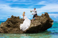 Happy Bride And Groom Having Fun On A Tropical Beach Under The P Royalty Free Stock Image - 48949146