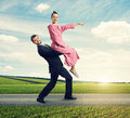 Woman Sitting On Man And Pointing At The Way Royalty Free Stock Photos - 48953998