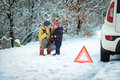 Woman With A Child On The Winter Road Royalty Free Stock Photography - 48995707