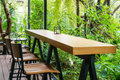 Coffee Table And Chair In The Green Garden. Royalty Free Stock Photography - 48998827