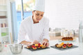 Pastry Chef Preparing Cupcakes Stock Images - 49015374