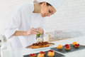 Pastry Cook Preparing A Cake Royalty Free Stock Images - 49015549