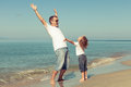Father And Son Playing On The Beach At The Day Time. Royalty Free Stock Images - 49020229