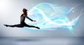 Cute Teenager Jumping With Abstract Blue Scarf Around Her Royalty Free Stock Photos - 49022028