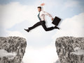 Funny Business Man Jumping Over Rocks With Gap Royalty Free Stock Photo - 49022795