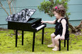 Little Girl Playing On Toy Piano Royalty Free Stock Photography - 49030087