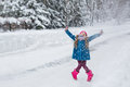 Little Girl Dressed In A Blue Coat And A Pink Hat And Boots, Hamming And Playing In The Winter Forest Stock Photo - 49046710