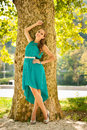 Young Girl Fashoionable Dressed Posing In Park Stock Photos - 49079853