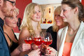 White Friends Tossing Glasses Of Red Wine Royalty Free Stock Photo - 49083905