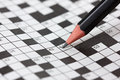 Crossword Puzzle And Black Pencil Stock Photography - 49100932