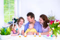 Family Having Breakfast On Easter Day Royalty Free Stock Photography - 49101717