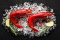 Fresh Big Red Shrimp On Ice On A Black Stone Table Royalty Free Stock Photos - 49103218