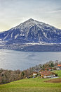 Niesen Mountain And Lakeview Near Thun Lake In Swiss Alps In Win Stock Images - 49107264