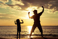Father And Son Playing On The Beach At The Day Time. Royalty Free Stock Photography - 49113087
