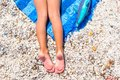 Closeup Of Little Girl Legs On Tropical Beach With Royalty Free Stock Photography - 49116547