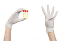 Medical Theme: Doctor S Hand In White Gloves Holding A Transparent Container With The Analysis Of Urine On A White Background Stock Photography - 49120502