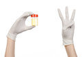 Medical Theme: Doctor S Hand In White Gloves Holding A Transparent Container With The Analysis Of Urine On A White Background Royalty Free Stock Image - 49120506