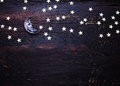 Glitter Golden Stars And Glass Moon On Grunge Wood Royalty Free Stock Photos - 49124338