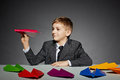 Boy In  Suit Launching Color Paper Plane Royalty Free Stock Image - 49127006