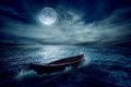 Boat Drifting Away From Past In Middle Of Ocean After Storm Without Course Royalty Free Stock Photography - 49149367