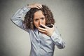 Shocked Funny Looking Young Woman, Surprised She Is Losing Hair Royalty Free Stock Images - 49150899