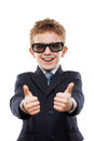 Smiling Child Boy In Business Suit Wearing Sunglasses Gesturing Royalty Free Stock Photo - 49156865