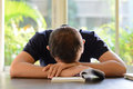Young Man Sleeping On The Table With Book Opened Royalty Free Stock Image - 49197986