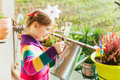 Little Girl Watering Plants On The Balcony Stock Images - 49202944