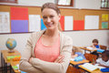 Pretty Teacher Smiling At Camera With Arms Crossed Royalty Free Stock Photo - 49208205
