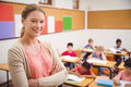 Pretty Teacher Smiling At Camera At Top Of Classroom Stock Image - 49208241