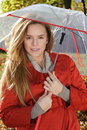 Young Beautiful Woman In The Park In A Fashion Shot, Looking Away And Smiling - Caucasian Woman, Autumn, Fall, Park, Umbrella Stock Photos - 49210903